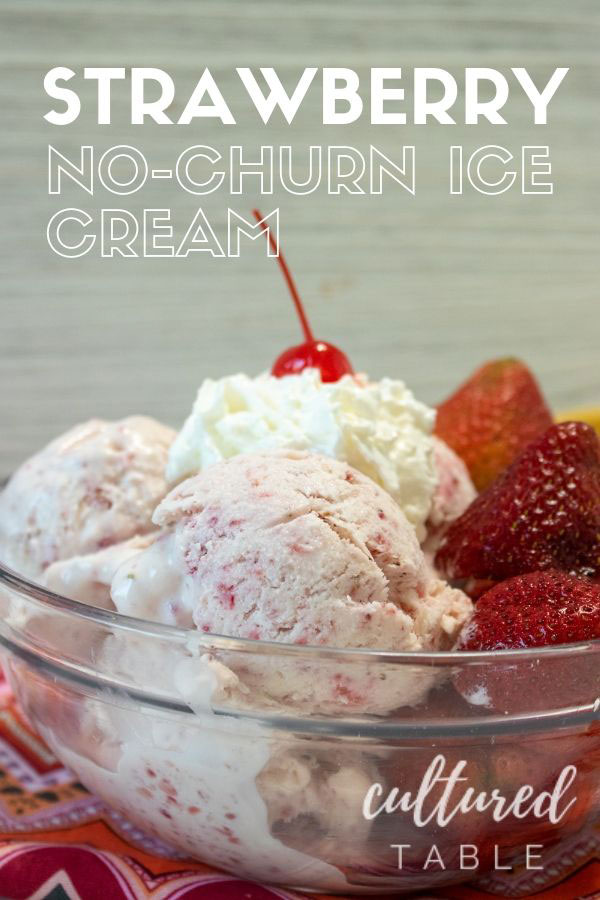 homemade strawberry ice cream in a clear glass bowl