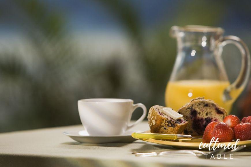 pitcher of orange juice on breakfast table