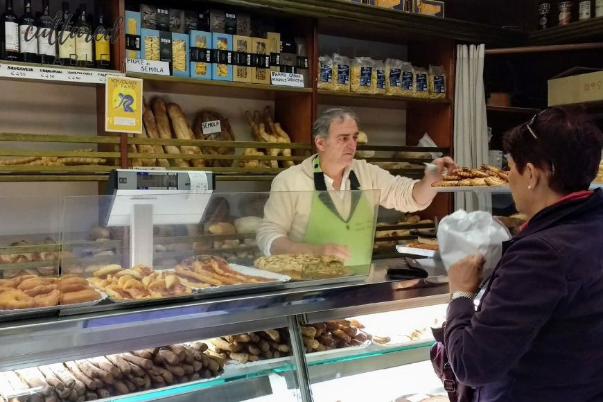 italian bakery with man behind counter