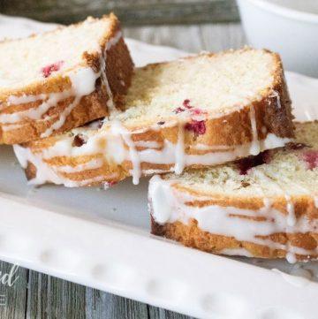cranberry lemon cake on a white dish
