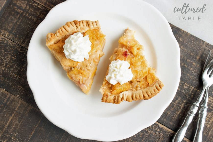 PEACH PIE ON A WHITE PLATE FROM ABOVE