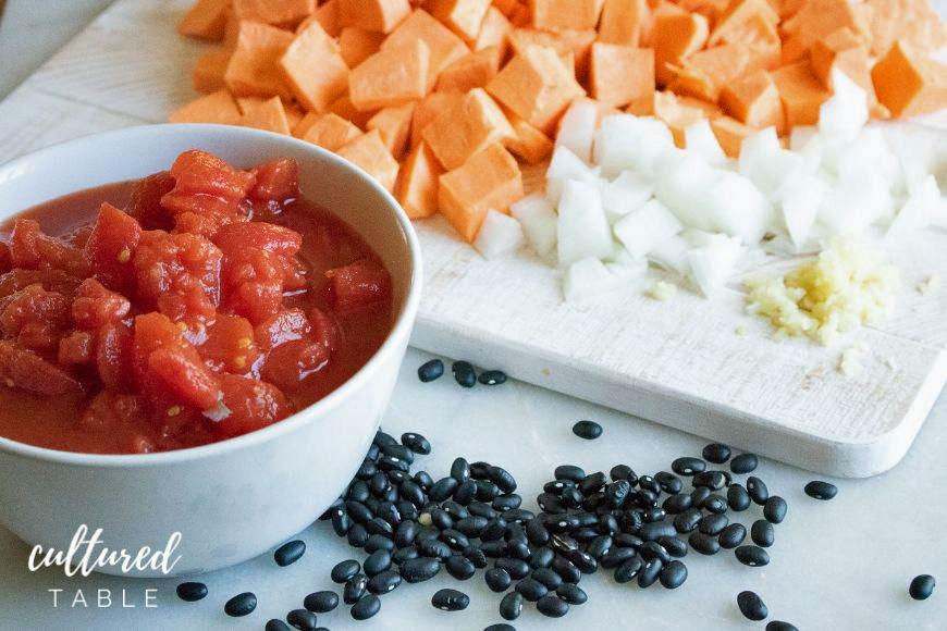 canned tomatoes, black beans, chopped onion, chopped sweet potato