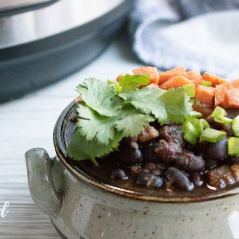 sweet potato black bean chili in a earthenware bowl