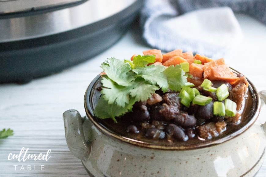 sweet potato black bean chili in a earthenware bowl