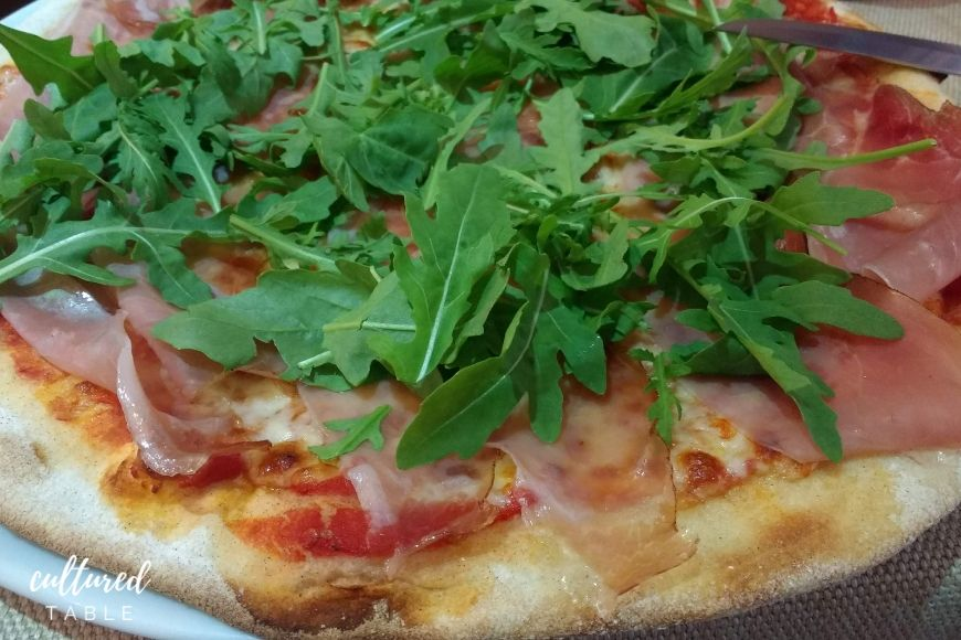 pizza in italy is topped with fresh ingredients
