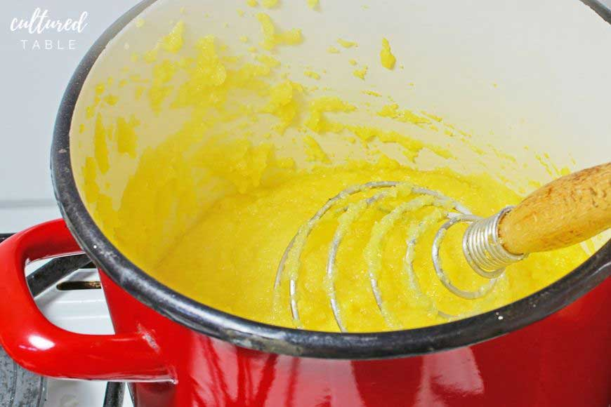 COOKING cornmeal in a red pot