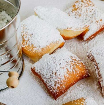 powdered sugar on fried dough