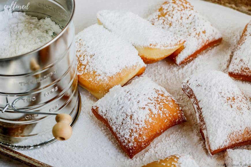 powdered sugar on fried dough