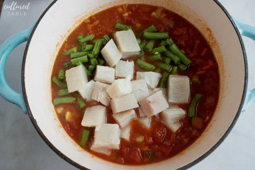 adding fish and green beans to the fish stew recipe