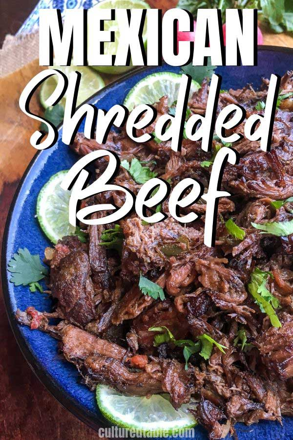 mexican shredded beef on a blue plate