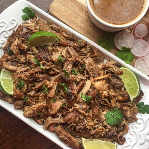 white tray of shredded pork for carnitas