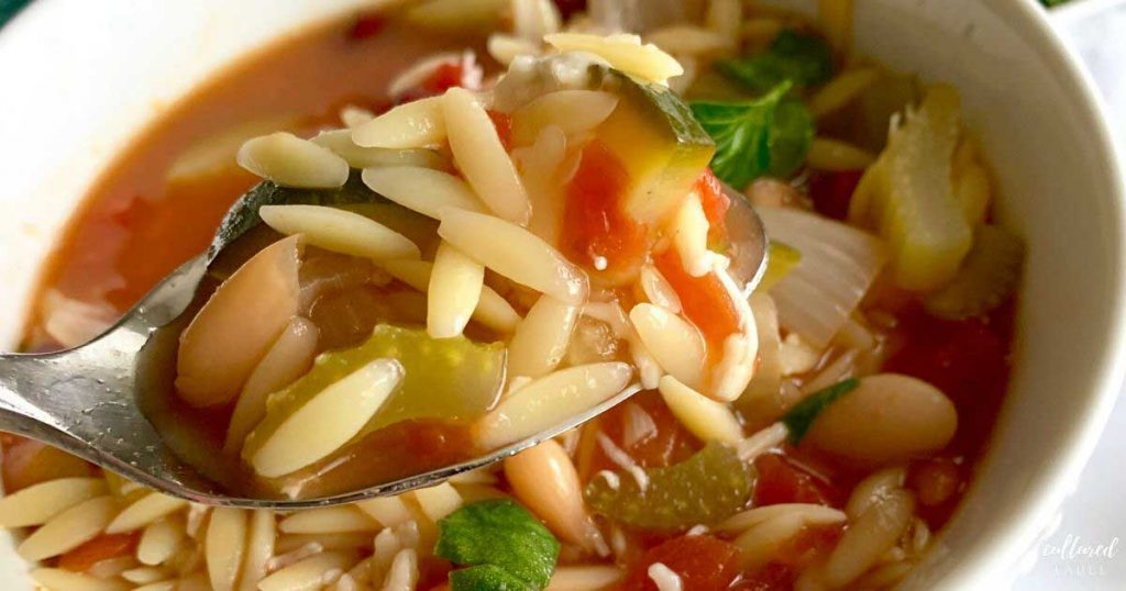 spoonful of minestrone soup with orzo