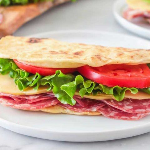 piadina sandwich on a white plate