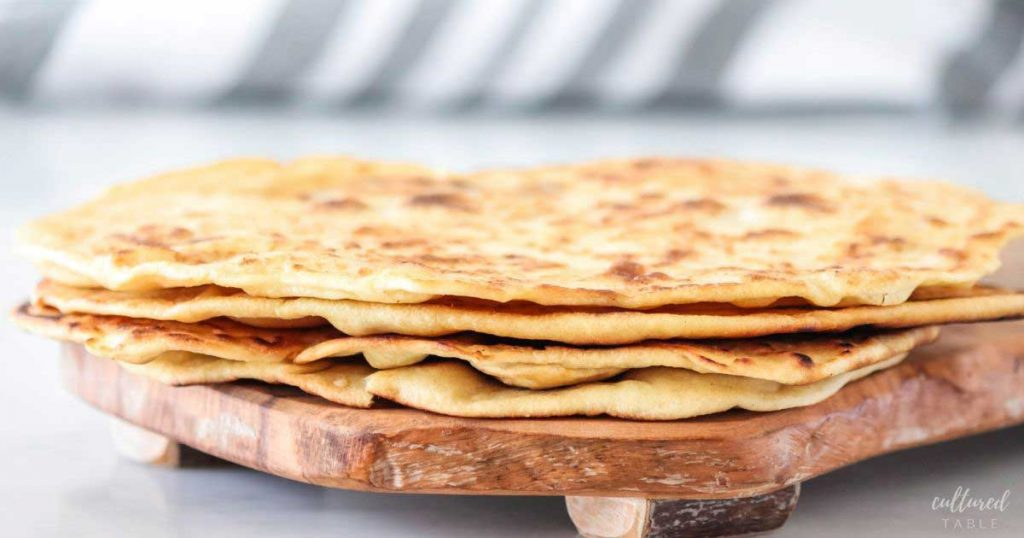 stack of piadina flatbread on a cutting board