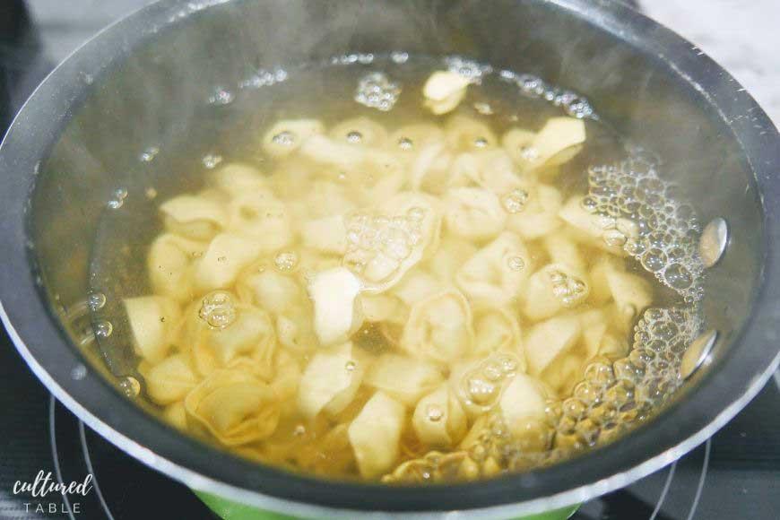 boiling tortellini in a pot