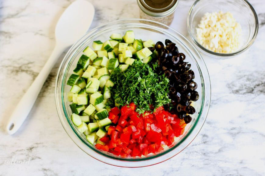 ingredients for quinoa salad in a glass bowl