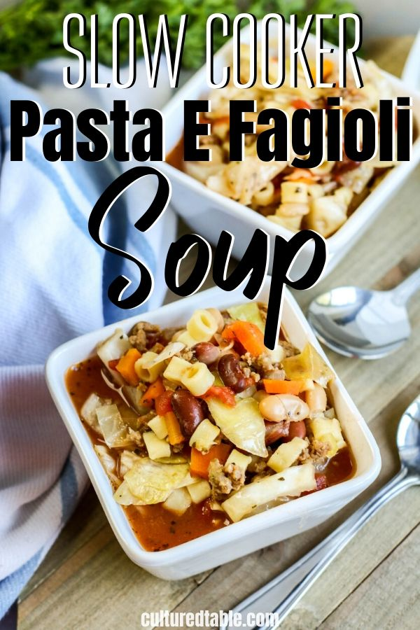 pasta e fagioli in a square bowl with a spoon from above