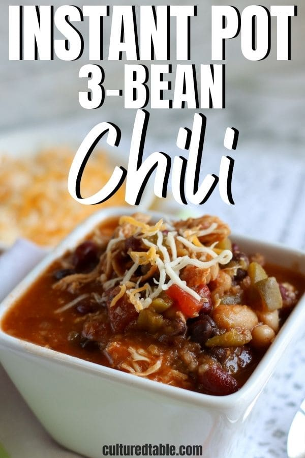 3-bean chili in a square bowl with cheese on top