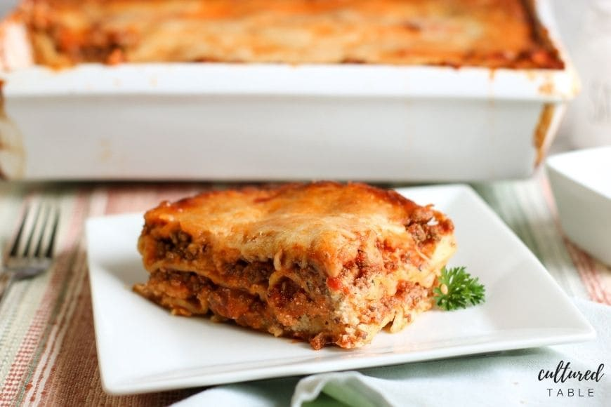 slice of meat lasagna on a white plate