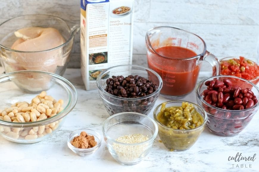 ingredients for chicken 3-bean chili in separate glass bowls