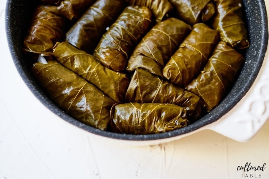 stuffed grape leaves in a cast iron pan