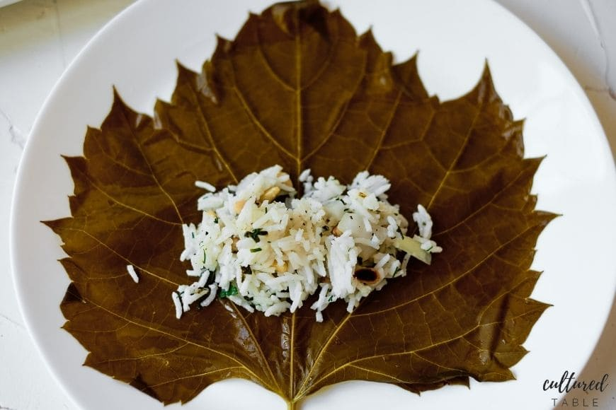 unrolled grape leaf with rice in the middle