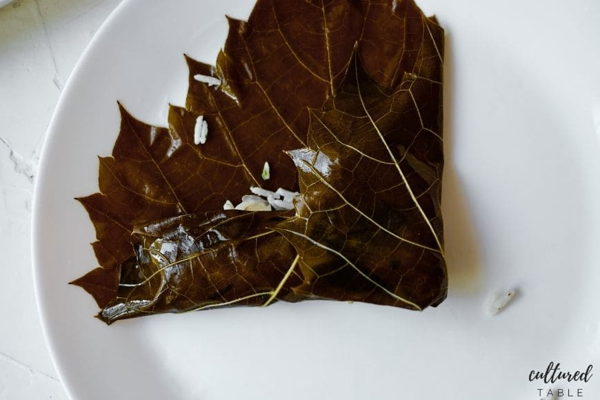 grape leaf with rice in the middle, half folded