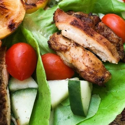 chicken schwarma wrap with cucumber, cherry tomatoes, and lemons