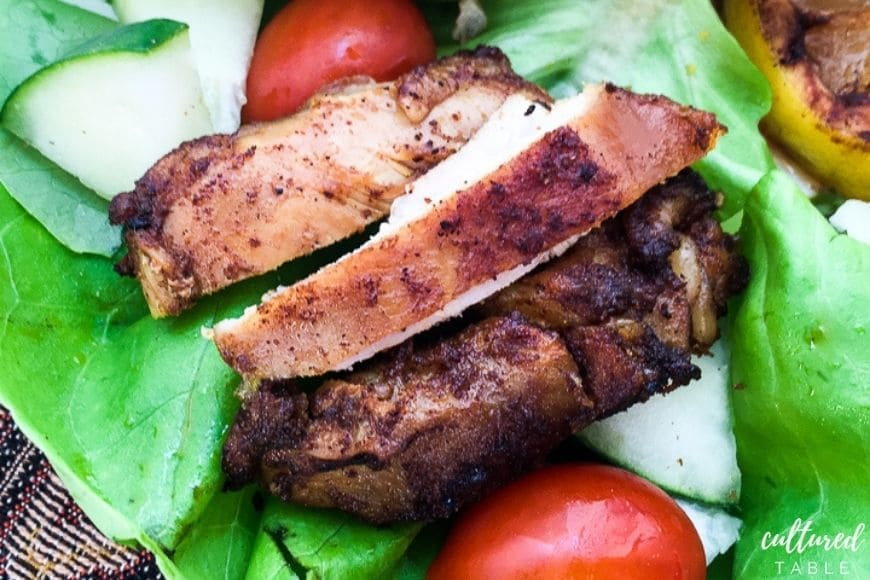 chicken shawarma wrap with tomatoes and cucumber