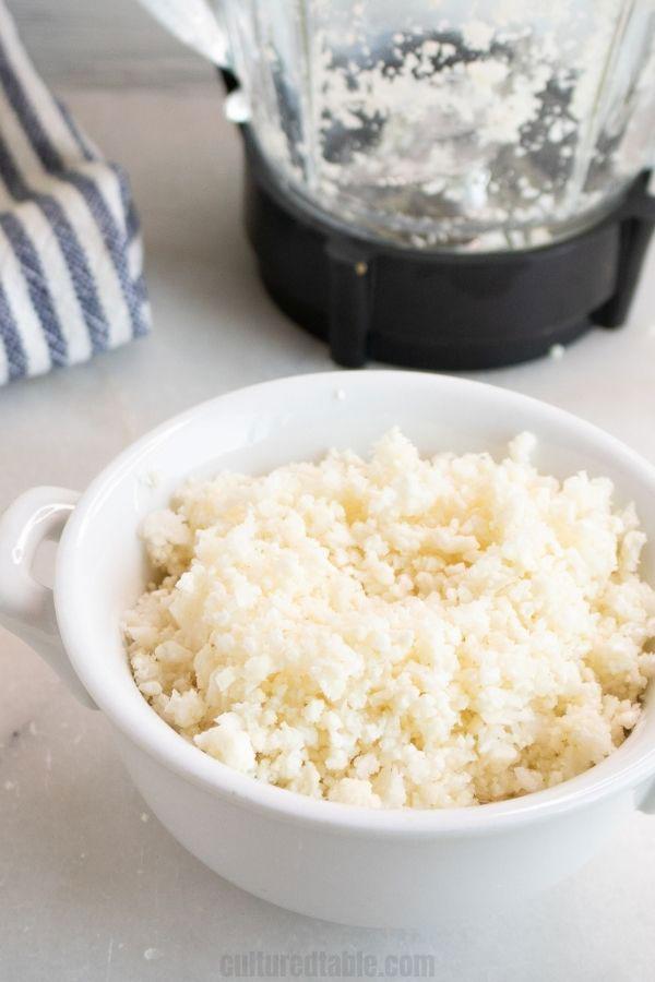 riced cauliflower in a white bowl