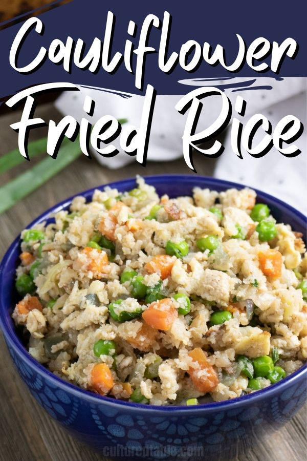 cauliflower fried rice in a deep blue bowl