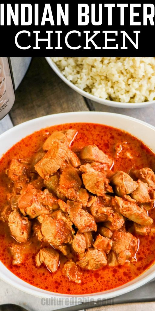 red sauce with cubed chicken in a white bowl