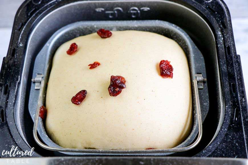 dried cranberries on top of bread in a bread machine