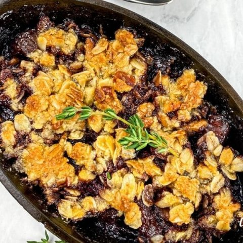 cherry crisp in cast iron ramekin