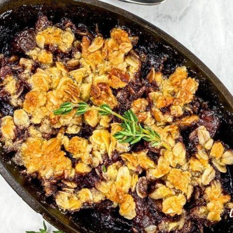 cherry crisp in cast iron ramekin