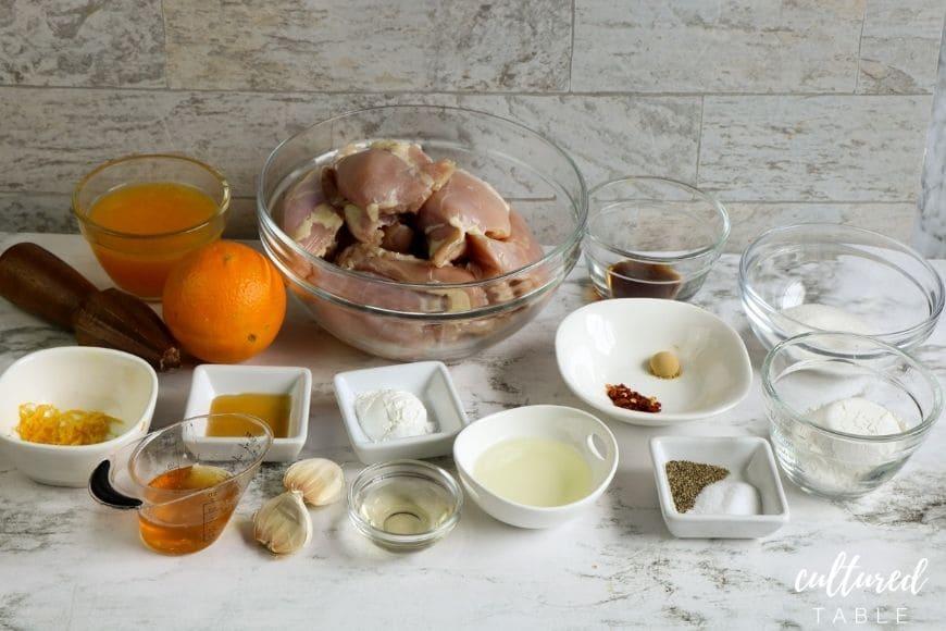 ingredients for orange chicken in separate bowls