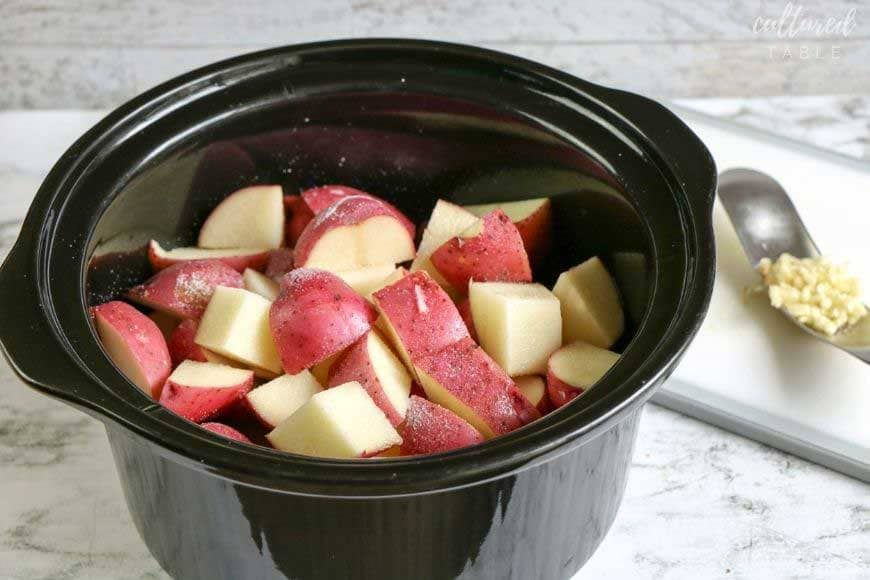 chunks of red potato in a slow cooker