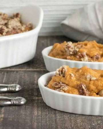 sweet potato casserole in white dishes on a dark wood background