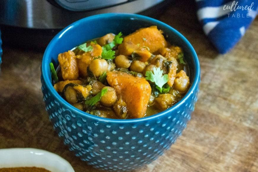 blue dotted bowl with vegetable curry in it