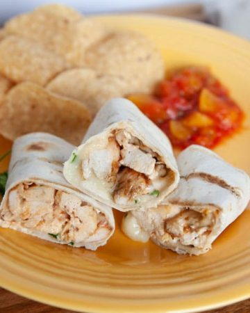 grilled chicken wraps on a fiesta yellow plate