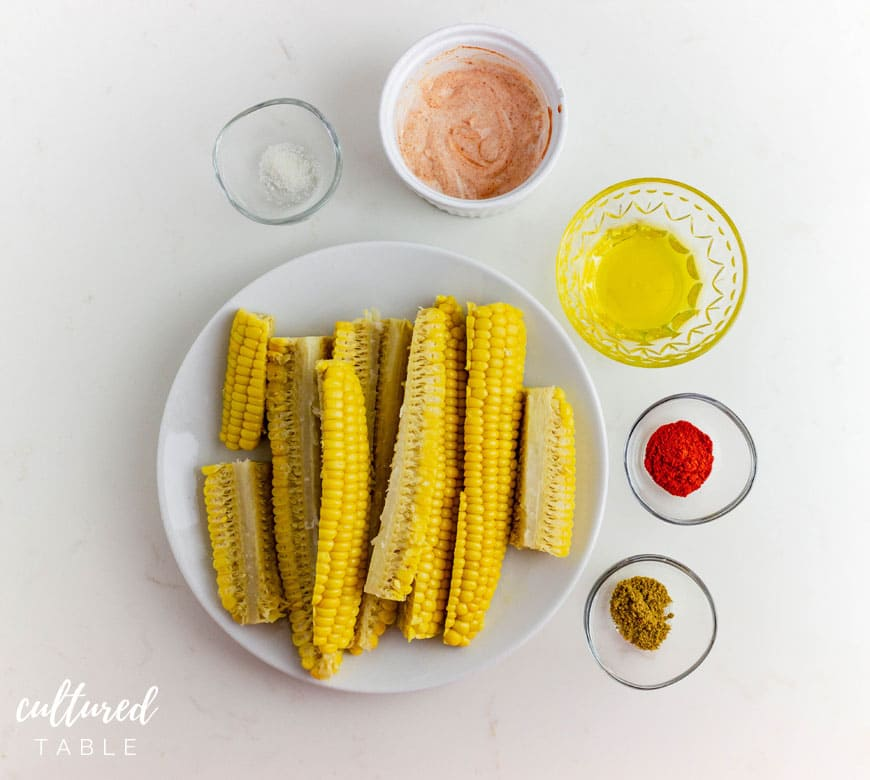 corn on the cob cut lengthwise with spices