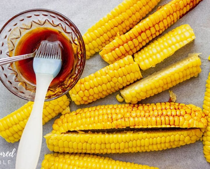 bowl of basting sauce, some spread on yellow corn ribs