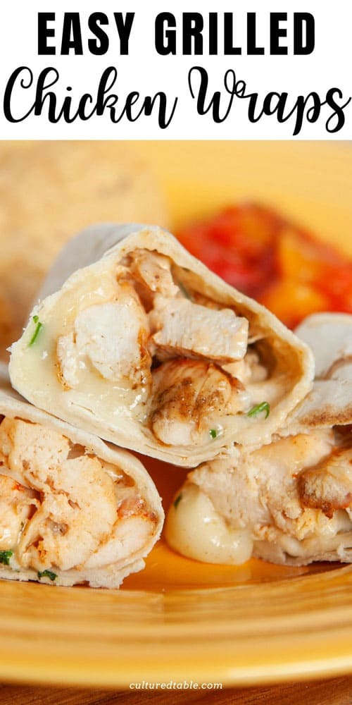 close up of wraps cut in half, chicken and melted cheese visible