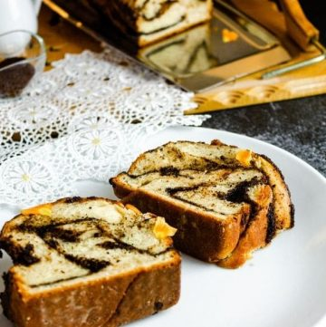 2 thick slices of chocolate babka on a white plate