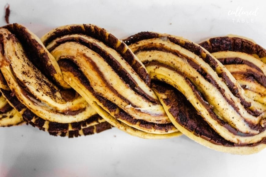 unbaked babka bread, twisted, with chocolate filling visible.